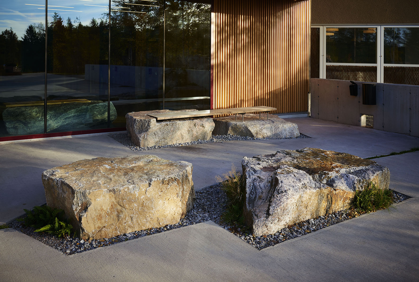 building with stone slabs surrounded by concrete