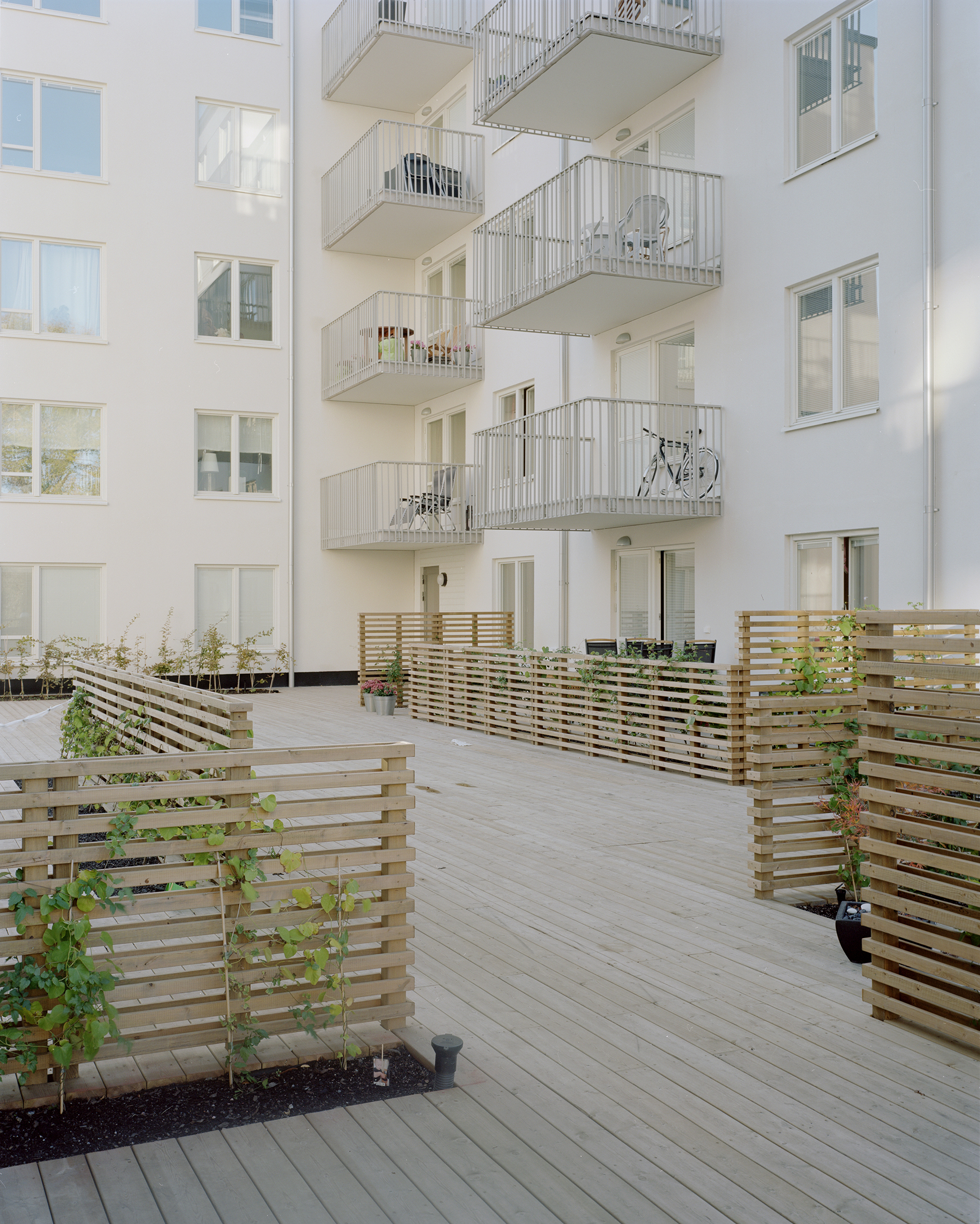 wooden walkway between apartments